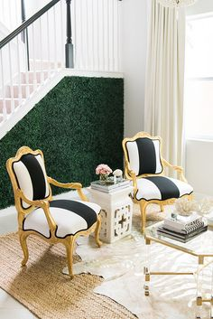 Black, white, and gold chairs