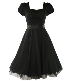 Black heavy cotton tea dress with puff cap sleeves. Black satin belt to clench in waist. Material bow to upper front. Invisible zip to side. Hidden elastic strip to back for perfect fit. Black cotton underskirt edged with black netting.  Main picture shows dress being worn with Hell Bunny long length petticoat (available to purchase separately). Petticoat is not included with the dress.  Machine washable  Material: 97% Cotton 3% Elastane Length: Knee Length