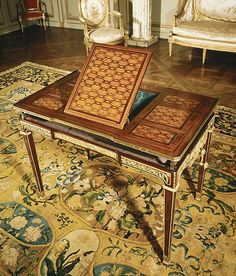 Mechanical Table once owned by the Viscountess Harcourt (Mary Ethel Burns) and some time before her by Marie Antoinette at the Chateau of Versailles; now at the Metropolitan Museum of Art