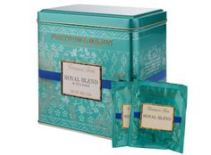 Fortnum & Mason Famous Teas collection Royal Blend tea tin in signature blue-green colour, with floral decoration and blue band, 2000s, London, UK