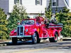 Fine Art Prints by Susan Savad! - 'Old Fashioned Fire Truck' - This old fashioned fire truck was waiting on a side street before a parade. It looked interesting to me because it looks more like an actual truck than the usual fire engine that I usually see. #firetruck #fireengine #fireman #firemen AS LOW AS $37
