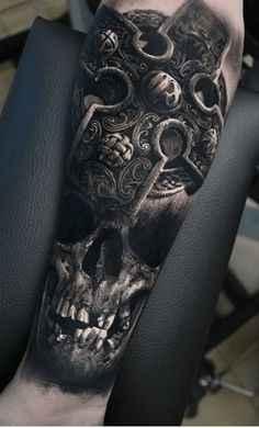 Inner forearm skull tattoos for men