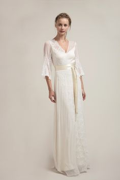"""LD6001 l For a truly bohemian bride, this 3/4"""" sleeves silk chiffon dress has original leaf embroidery that will mesmerize. The embroidery is placed diagonally around the front and back bodices creating interesting details from all angles. #sajawedding"""