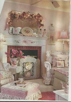 Pink and white shabby chic with white fireplace mantle, roses, so much to love!