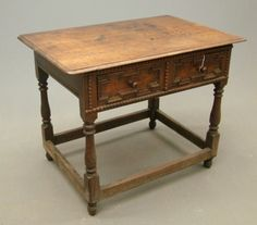 TAVERN TABLE - a small, low table, whose top - rectangular or round - overhangs the base; the earliest styles, featured elaborately turned legs and stretchers typical of William and Mary furniture, developed in England in the late 1600s, it flourished there and in America until the early 1800s