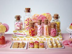 Miniature dessert table with candy/cookies sculpted out of polymer...LOVE it!