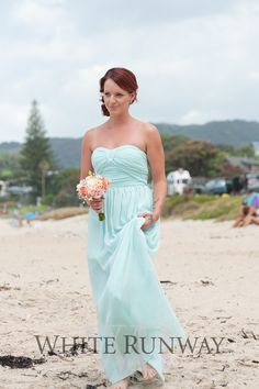 Our gorgeous bride Sara tied the knot at Lang's Beach, Waipu, New Zealand. Sara opted for the Making History Dress in Tiffany Blue for her four bridesmaids.#whiterunway #weddingflash #realrunway
