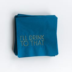 "Complete your bar with a stack of contemporary, cheeky cocktail napkins.   	Paper cocktail napkins 	4.75"" x 4.75"" 	Navy cocktail napkins with metallic gold foil printing that says ""I'll Drink To That"" 	Set of 25 napkins 	Made in the USA"