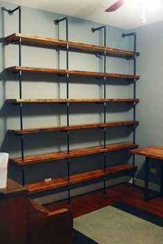 Combination of three things I am very fond of; reclaimed wood, metal pipes used as structural support, and bookshelves.