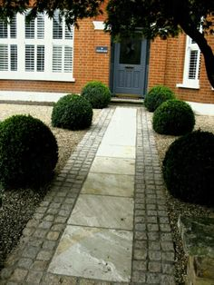 magnificent box balls were supplied by Provender Nurseries, Swanley, Kent, for this garden I designed in south-east London. The pale paving is edged with buff-coloured granite setts which work well with the brickwork of the house. Front Garden Path, Front Yard Garden Design, Front Path, Small Front Yard Landscaping, Garden Paths, Front Driveway Ideas, Front Door Steps, Garden Tips, Driveway Paving