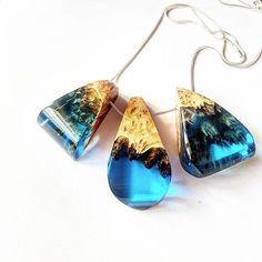 3 blue pendants mixed with wood and resin. .  Just love to look back on our work and  see how far we have come. . Hope you enjoy.  ArtfulResin.etsy.com . #pendant #bohostyle #reclaimed  #resin #resinjewelry #etsyhandmade  #etsyfinds  #madeinuk #jewellery #resincasting #resinjewellery #burl #etsyhunter  #etsyusa #jewelrydesign  #mydesign #handcrafted #imadethis #woodresin #gift #resincraft #madewithlove #bohojewelry #surfer  #resinart #designer #woodjewelry #etsyuk  #ArtfulResin…