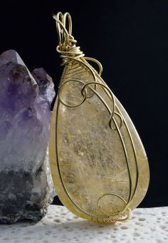 A unique, handmade, wire wrapped pendant with Rutilated Quartz golden hair crystal. Pendant was made by Me, using an extremely labor-intensive and precise wire-wrapping technique, with brass wire Dimensions of pendant:  length: 6.9 cm 2.71 inch width: 3.2 cm 1.25 inch  You receive this unique pendant in jewelry box, so it is ready to be a gift.  ---------On this auction you buy pendant without chain.---------   Refunds and Exchanges:  If you are not satisfied with your purchase for any…