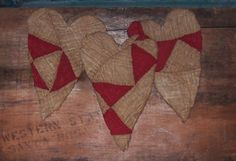 Primitive heart ornaments, made from antique red & white quilt by Prairie Primitives Folk Art.