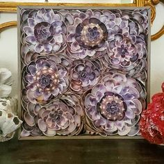 """12"""" x12"""" square, original Seashell Sculpture, wall hannging. Using Purple Cocquina, Clams, Knobby Sea Urchins and Purple Cowrie top flowers, I've created my first wall pannel, art sclupture. 💜 I'm having fun thinking outside of the Box and creating what comes to mind these days. $345.00 . . . #customdesigns #seashellart #interiordesign #coastaldesign #beachhouse #shellart #shellartist #seashellsclupture Elegantshells.net Seashell Chandelier, Seashell Art, Top Flowers, Sea Urchins, Fireplace Surrounds, Beach Art, Coastal Living, Sea Shells, Decorative Boxes"""