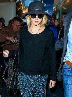 Star Tracks: Monday, December 22, 2014   MAD HATTER   She's trying to go low profile in a cute hat and shades but we still recognize Jennifer Lawrence as she makes her way through LAX on Thursday.