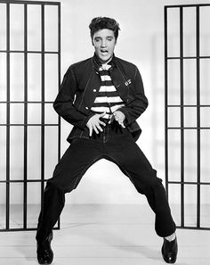 1957: Elvis Shakes Up the Pants Establishment   Presley puts on a black denim jacket and jeans for Jailhouse Rock. Black jeans soon become a crucial part of any respectable rock-and-roll uniform.