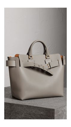 A belted tote influenced by our iconic trench, panelled inside and out in supple two-tone leathers. Top Designer Handbags, Big Handbags, Leather Belt Bag, Unique Bags, Purses For Sale, Burberry Handbags, Luxury Bags, Handbag Accessories, Shoe Bag