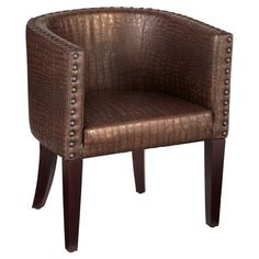 Tub chair with croc-inspired faux leather upholstery and nailhead trim.  Product: ChairConstruction Material: Wo...