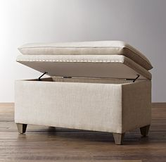 RH Baby & Child's Classic Nailhead Upholstered Storage Bench:Double-duty pieces like ours are always welcome in a child's room and look right at home at the end of the bed. Inside, there's room to store everything from bedding to books to toys, while the cushioned top provides an invitingly comfy seat.