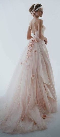 Cherry Blossom Wedding Dress - What a beautiful use of the delicate cherry blossoms in both the dress and the hair decoration.