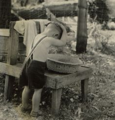 +~+~ Vintage Photograph ~+~+    Little one washing his hair in outside metal basin.  1941.