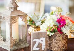 Pretty rustic centerpeices with lantern and wooden vases and table numbers by Emily Clarke Events. Floral by Di Fiori. Photo by Jennifer Yarbro Photography. #wedding #centerpiece #rustic #wood #pink #orange