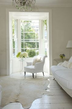 I like the open windows and natural light with light wooden floors; very fresh; could work for nook in master bedroom