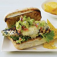 These tangy Go Green Chicken Sammies aret topped with a spicy-cool combo of pico de gallo and guacamole|  http://www.rachaelraymag.com/Recipes/rachael-ray-magazine-recipe-search/rachael-ray-30-minute-meals/go-green-chicken-sammies