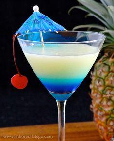 PINA COLADA-TINI 2 oz. rum 1 oz. coconut rum 2 oz. pineapple juice 1 oz. cream of coconut ½ oz. blue curaçao Garnish as desire