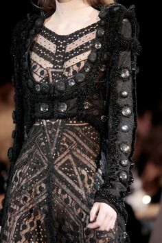 Givenchy Gowns Pagan Wicca Witch: Ornate, witchy black gown with sleeve detail.