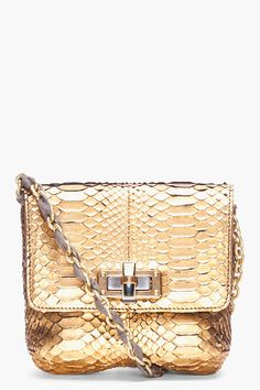 Faux leather snake skin clutch with magnetic closure, comes with chain shoulder strap, 3 compartments, 2 ID windows, and credit card holders. 8 (w) x 1.5 (d) x 4.5 (h)