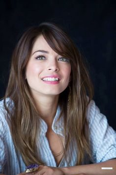 Kristin Kreuk Pretty Long Hairstyles with Side Swept Bangs