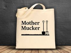 Mother Mucker Funny Joke Horse and Farm Bag for Horseback Riding Equestrians.  A roomy tote bag with a square bottom thatll hold whatever you need to carry. Makes a great gift for anyone that spends their days mucking out stalls and paddocks!  • 100% cotton canvas • Dimensions: 14