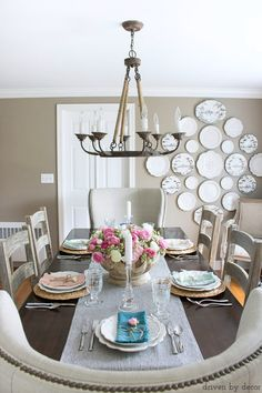 Beautiful neutral dining room with amazing plate wall kellyelko.com