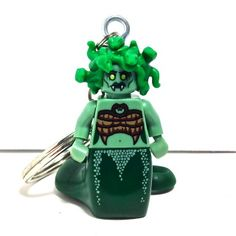 Believe it or not, this is her happy face!   http://www.brickshtick.com/store/p98/Green_Medusa_Minifigure_Pendant_or_Key_Chain.html