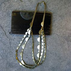 http://shop.tasknewyork.com/product/half-moon-necklace      half moon necklace - brass