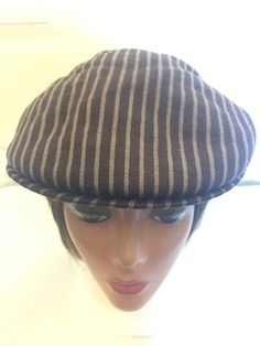 ❘❘❙❙❚❚ ON SALE ❚❚❙❙❘❘     Kangol Brown Cap With Taupe Stripes, Size Large, Vintage. Excellent vintage condition.  Please keep in mind that these are vintage pieces which may be anywhere from 20 to 70 years old. This being said, they may show some signs of wear, which I feel adds to the character and charm of the design.  You may browse more items in my shop at: www.etsy.com/shop/LunasVintageDesigns  NO REFUNDS, SO PLEASE ASK ANY QUESTIONS PRIOR TO PURCHASE.  International buyers, pl...