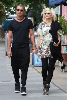 Celebrity Street Style: The 10 Most Stylish Stars - Gwen Stefani | With husband Gavin Rossdale wearing a graphic fit-n-flare dress with black skinny jeans and caged heels