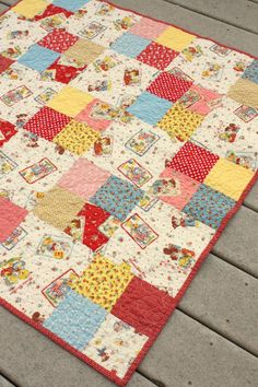Simple Four-patch Baby Quilt - Diary of a Quilter - A Great I Spy Quilt!Four-patch Baby Quilt (Kit for sale, but a cute idea to DIY too!Simple Four-patch Baby Quilt - this one is pretty busy, but like the pattern.super sweet, yet simple merry bon bon Quilt Baby, Baby Girl Quilts, Girls Quilts, Kid Quilts, Chevron Baby Quilts, Patchwork Quilting, Scrappy Quilts, Easy Quilts, Small Quilts