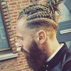 men's braids and bun with side undercuts