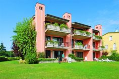 Residence Virgilio - Sirmione ... Garda Lake, Lago di Garda, Gardasee, Lake Garda, Lac de Garde, Gardameer, Gardasøen, Jezioro Garda, Gardské Jezero, אגם גארדה, Озеро Гарда ... Welcome to Apartments Virgilio Sirmione. The Residence Virgilio is splendidly situated on the edge of the lake and was inaugurated in the Spring of 1995. It has 21 luxuriously furnished mini-apartments set in a beautiful garden with a swimming-pool, private garages and lift. Each ap