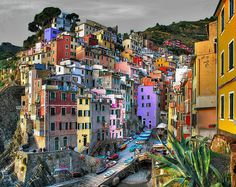 Riomaggiore, Italy. Definitely worth a visit. Its real and not photoshopped! :)