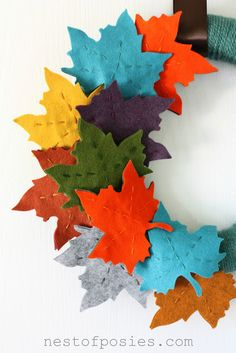 Felt Leaf Wreath Fall Felt Leaf Wreath - would be gorgeous against any background. Great pops of color! via Nest of PosiesFall Felt Leaf Wreath - would be gorgeous against any background. Great pops of color! via Nest of Posies Felt Wreath, Wreath Crafts, Diy Wreath, Diy Crafts, Wreath Fall, Mesh Wreaths, Twine Wreath, Yarn Wreaths, Leaf Crafts