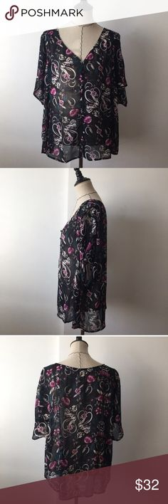 NWT torrid floral paisley v neck blouse Super cute v neck floral blouse! No buttons are missing. Brand new with tags. Size 1. 100% polyester. Pit to pit approx 23.5. Length approx 27. torrid Tops Blouses