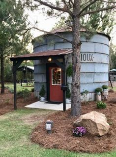 A grain silo converted into a TINY escape. It's my piece of heaven. I love hearing rain on the metal roof. It's very rustic. Amenities include a pavilion, charcoal grill, fire pit with swings, small playground, and a full size bed