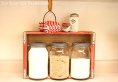 cute kitchen vignette: coke crate, glass canisters + vintage elements - love the potato masher with folded clothes placed in it!