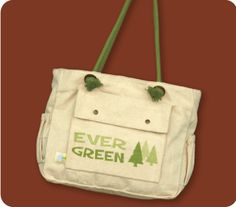 EVER GREEN~Go beyond basic. Designed with your mobile lifestyle in mind, Tote is big and roomy inside, with 2 small snap pockets and an attached key-holder. On the outside, there's a large front snap pocket, 3 back pockets, and elastic bottle pouches. Clever earth friendly graphics and unique rope shoulder straps.     Functional & Fashionable!   •Organic cotton canvas, organic cotton handles   •Machine Washable, dry flat   •16''x 11''x 6""