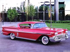 1958 Chevrolet Bel Air Impala. Nice in red. I like seeing a real shiny black also.