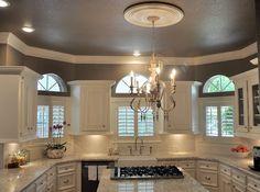 White kitchen with granite counter tops and subway tile backsplash
