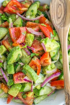 This Cucumber Tomato Avocado Salad recipe is a keeper! Easy, Excellent Salad | NatashasKitchen.com #recipe